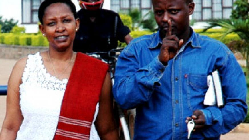WIFE AND HUSBAND: Embattled Pastor Charles Murenzi and his wife Jolly leave CID headquarters yesterday. (Photo/ J. Mbanda)