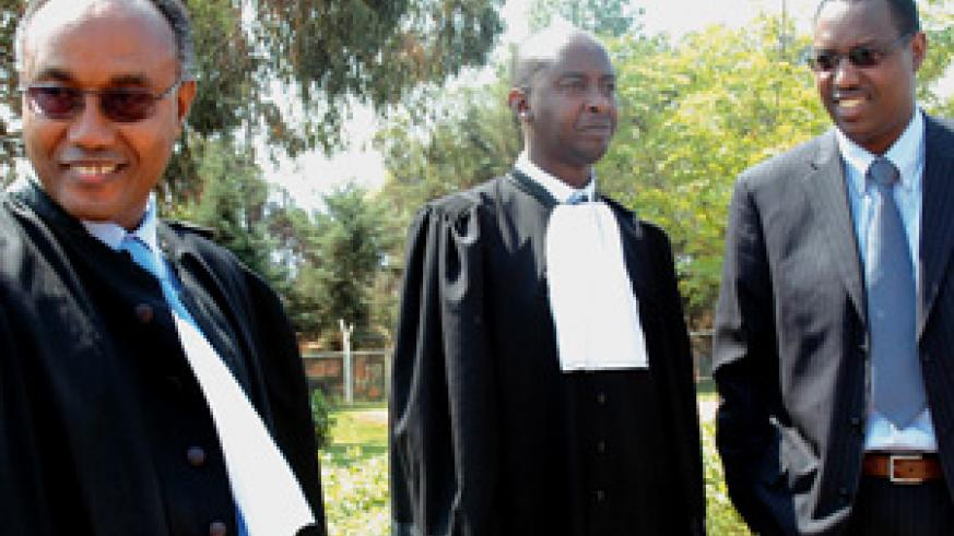 Mitali (right) and his party's lawyers Kazungu (left) and Serge Kayitare outside the High Court chambers yesterday. (Photo/ G. Barya)