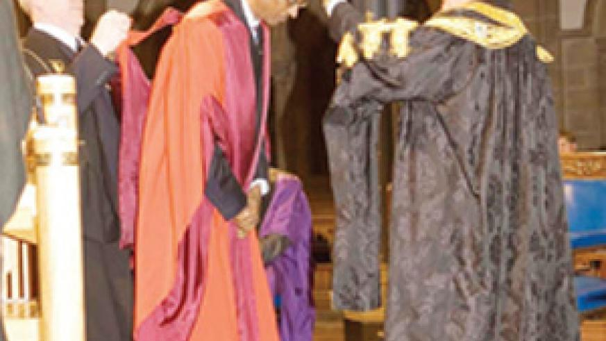 Kagame being conferred upon the honorary doctorate.