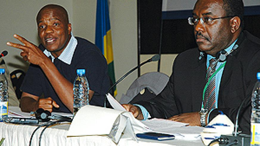 The Vice Chair of ACP Committee on Economic Development, Finance and Trade, MP Boyce Sebetela from Botswana (left) and ACP co-Chair, Senator Jean Marie Everistus from Saint Lucia at the meeting at Kigali Serena Hotel yesterday. (Photo/G. Barya)