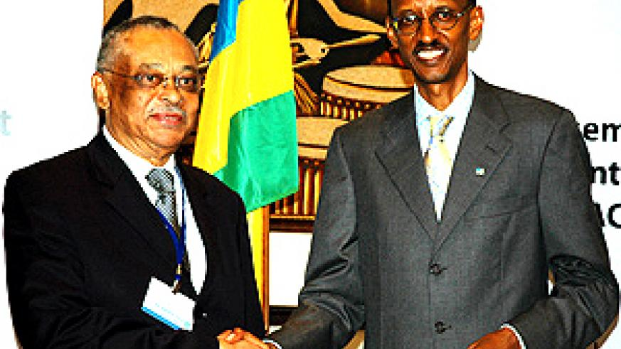 President Paul Kagame shakes hands with the René Radembino-Coniquet, the co-president of the ACP-EU Joint Parliamentary assembly after the official opening at Serena Hotel yesterday. (Photo/ G.Barya)