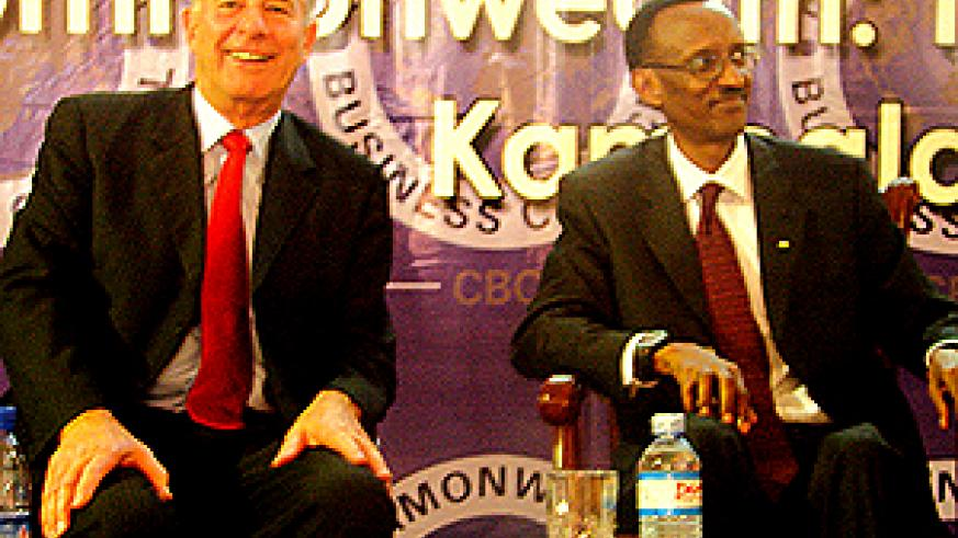 President Kagame and Don Mckinnon (L),the Commonwealth Secretary General, at the Commonwealth Business Forum in Kampala yesterday. (Photo/C. Kazoba)
