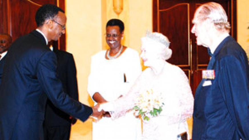 ROYAL HANDSHAKE: President Paul Kagame greets Queen Elizabeth II, while Uganda's First Lady Janet Museveni (centre) and Prince Phillip, the Duke of Edinburgh, look on.