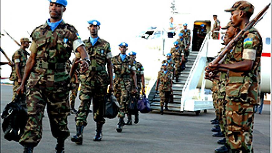A contingent of RDF peacekeepers arriving at Kigali International Airport yesterday. They are part of the 254 men who are being replaced by another 254 RDF soldiers in Khartoum, Sudan under the UN Mission in Sudan (UNMIS). (Photo/G. Barya)