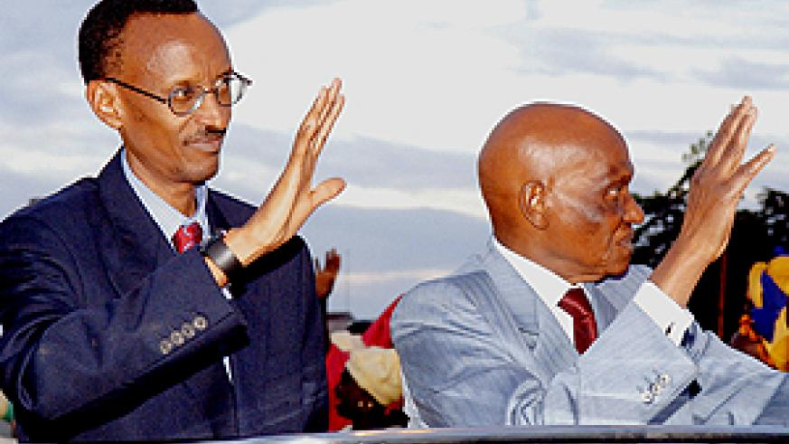 Presidents Kagame and Wade wave to crowds en route from Dakar airport on Wednesday. (PPU photo)