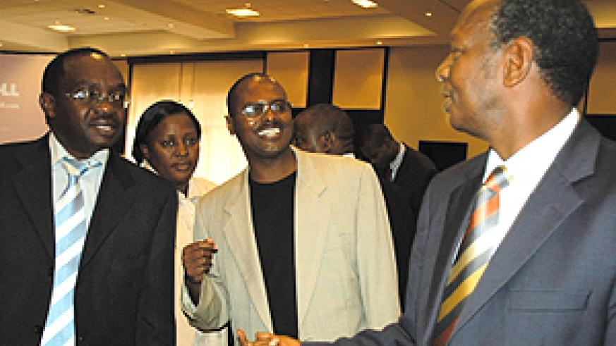 State Minister in charge of Water and Mines, Prof. Bikoro Munyanganizi (right) shares a light moment with Mayors François Byabarumwanzi (left) and Jean Paul Munyandamutsa, at Kigali Serena Hotel yesterday (Photo G. Barya)