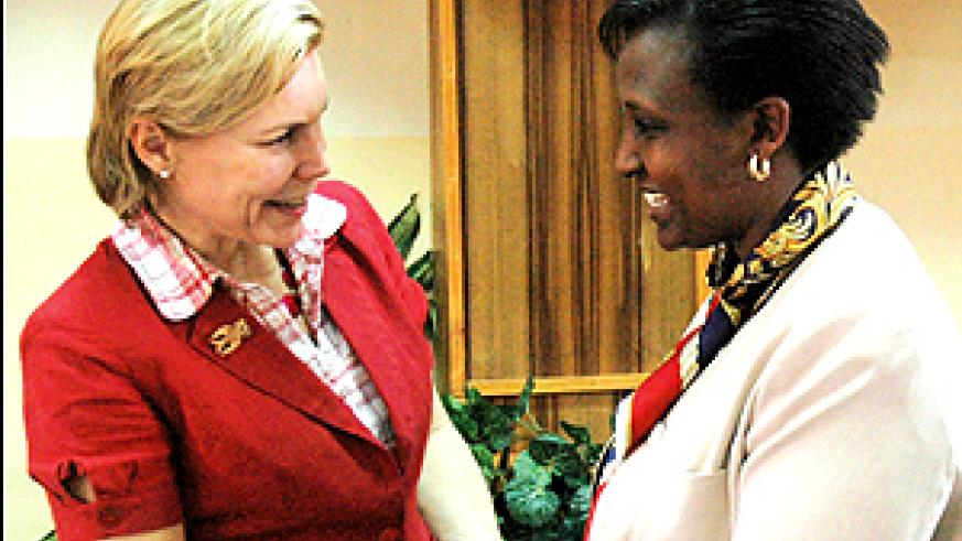State Minister for regional Cooperation Rosemary Museminari welcomes Sweden's Minister for International Development and Cooperation Gunilla Carlsson at the Ministry of Foreign Affairs yesterday. (Photo/J. Mbanda)