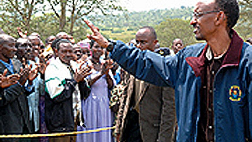 President Kagame greets the residents of Karangazi on arrival for the land re-distribution exercise on Wednesday. (PPU photo)