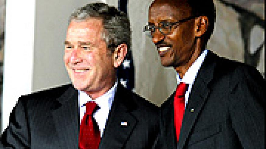 Kagame  and Bush shake hands after signing an investment treaty at Village Urugwiro yesterday. (PPU photo)