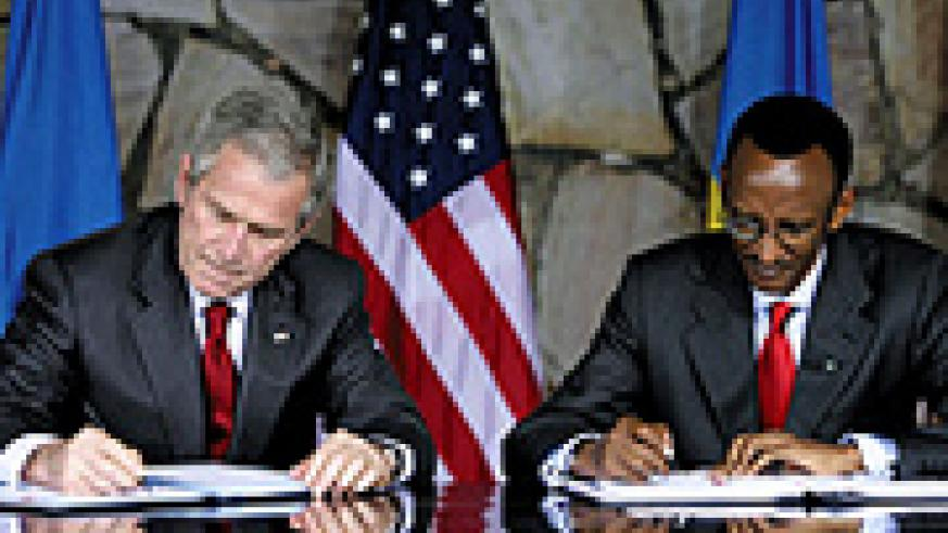Presidents Bush and Kagame sign a Bilateral Investment Treaty on Tuesday at Village Urugwiro. ( PPU Photo)