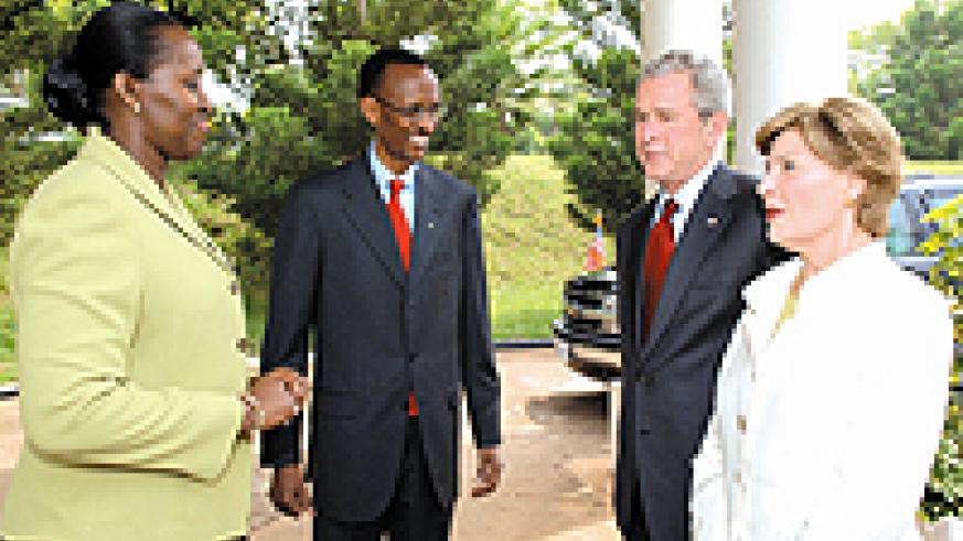 Presidents Kagame and Bush with their wives, Jeannette and Laura, during a chat at Village Urugwiro on Tuesday. (Courtesy photo)