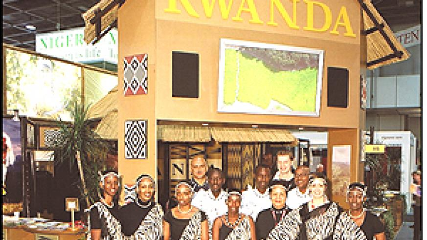 Rwandan exhibitors pose for a photo in front of their stand at last year's ITB-Berlin tourism trade fair, at which the country won the best exhibitor trophy. (Courtesy photo)