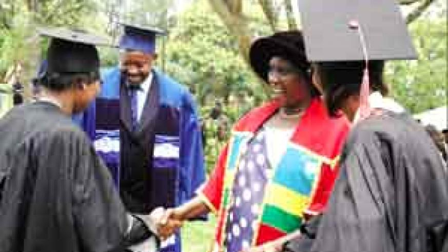 CONGRATULATIONS: Dr Gahakwa (2nd right) congratulates one of the graduands; looking on is Dr Ndushabandi (2nd left) yesterday at Jali Club. ( Photo / J. Mbanda)