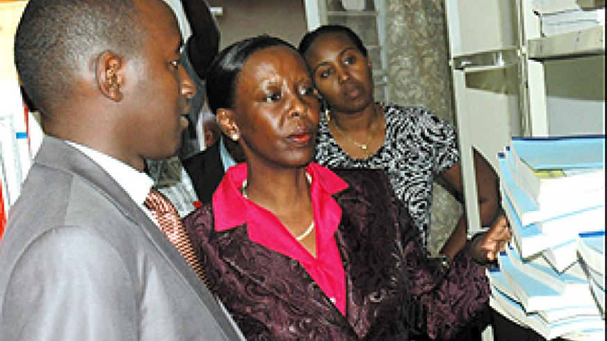 Information Minister Louise Mushikiwabo (C) at the High Council of the Press library in company of the council's Executive Secretary Patrice Mulama (L) and the Ag. president and Secretary, Thais Ruboneka. (Photo / J.Mbanda)