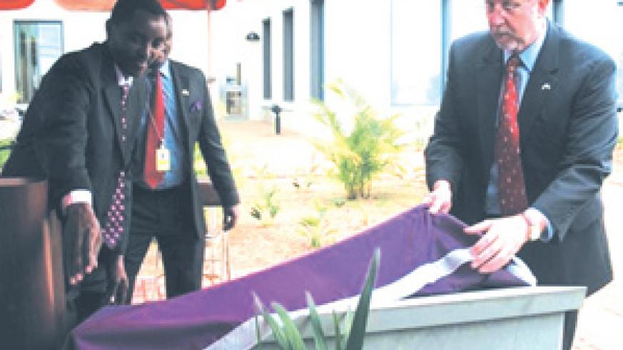 Mucyo and Amb. Ariette unveil the plaque for the 25 US Embassy staff who were killed during the 1994 Genocide.This was during a ceremony held at the embassy head offices in Kacyiru, Kigali on Monday. (Courtesy photo)