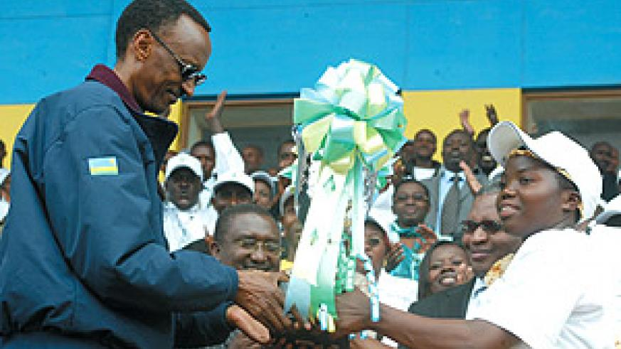 President Kagame receives a trophy from teachers in recognition of his unwavering support to the country's education sector. (Photo/G. Barya).