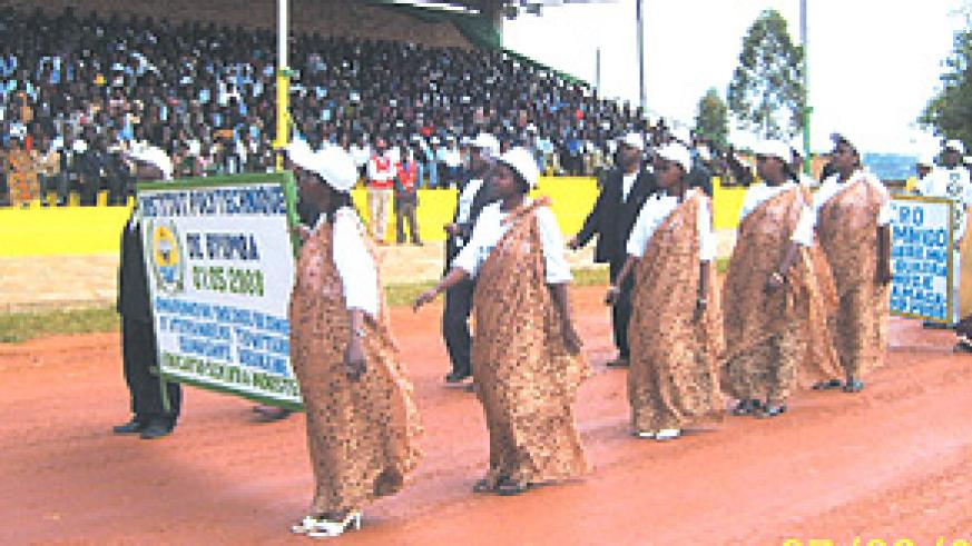 Staff of Byumba Polytechnique Institute during a march past at the national Labour Day cebrations at Gicumbi stadium, Gicumbi District in the Northern Province yesterday. (Photo/ A.Gahene).