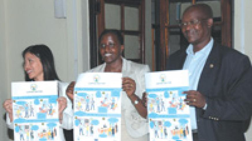 (L-R) Tse Karen Country executive officer I.B.J, Jacqueline Bakamurera assistant attorney General and Gatera Gashabana president of the Kigali bar association displaying  posters during the launch of the international Bridges to justice  yesterday.(photo