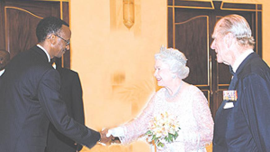 President Kagame shaking hands with the head of the Commonwealth, Queen Elizabeth II, in Kampala, during the previous Commonwealth Heads of Government Meeting in November, last year. Looking on is the Queen's husband, Prince Phillip. (File photo)