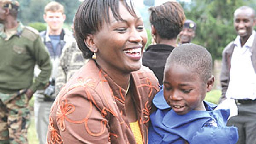 ORTPN's Director General, Chantal Rugamba, hugging a school girl at Nyabitsinde Primary School in Kinigi Sector, Musanze District. (Courtesy photo).