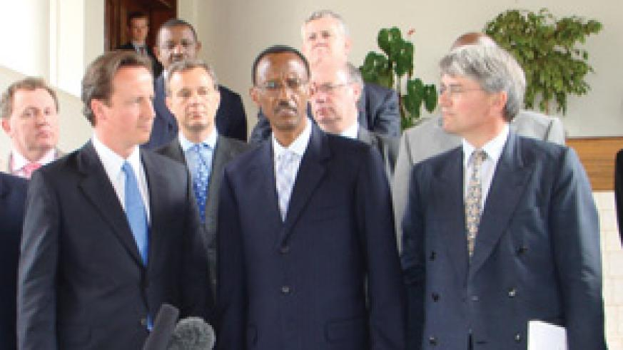UK Conservative Party leader David Cameron (L) and Andrew Mitchell meet President Kagame during a past visit to Rwanda (Courtesy photo)