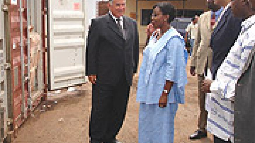 L-R: Egyptian Amb. Ahmed Ramy and State Minister Christine Nyatanyi at Magerwa depot. (Courtesy photo).