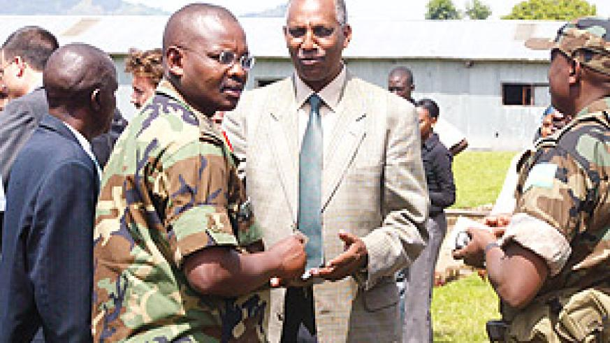 Brig. Gen Mushyo Kamanzi together with the head of the Rwanda Demobilisation Commission, Jean Sayinzoga at Mutobo.