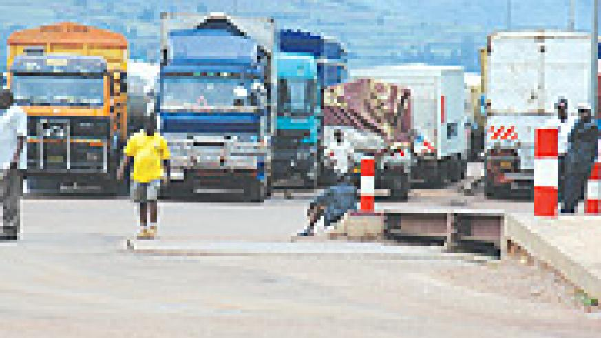 Trucks waiting for hours to be cleared at Gatuna border post. Importers complain that customs and immigration officials close early causing delays. (File photo)
