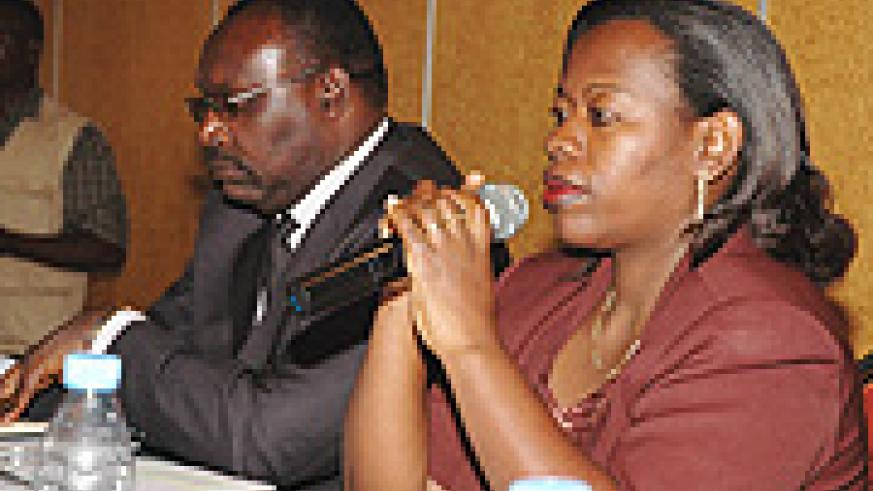 The Governor of BNR, Francis Kanimba (L) listens while MINICOM Minister Monique Nsanzabaganwa (R) responds on the rising Insurance rates. (Photo G.Barya).