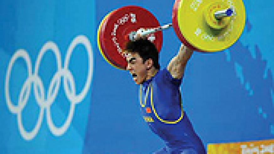 Liao Hui takes a snatch lift to win the 13th gold medal for the hosts yesterday.