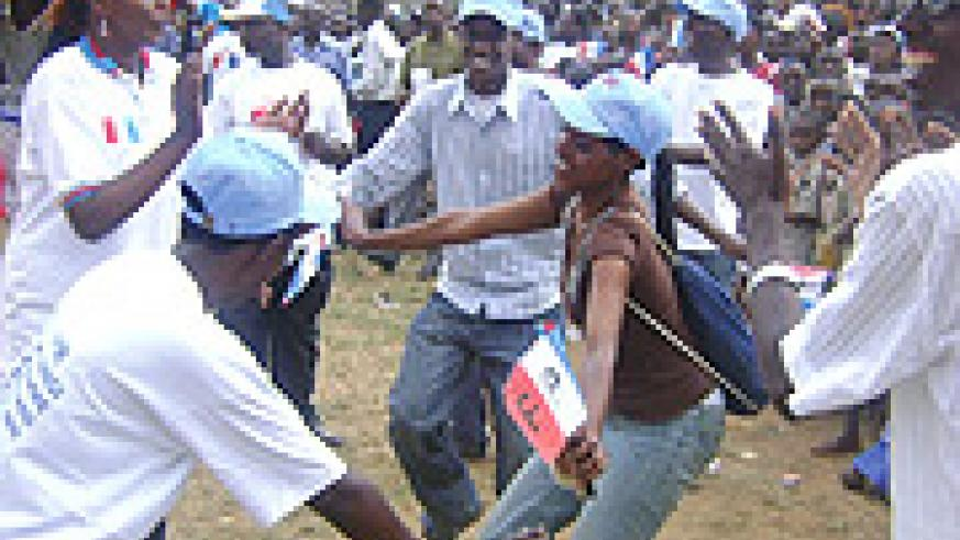 PARTY TIME!  Supporters of the RPF had time off for fancy dance strokes during a campaign rally at Karuruma in Gasabo district. (Photo/ E. Musoni).