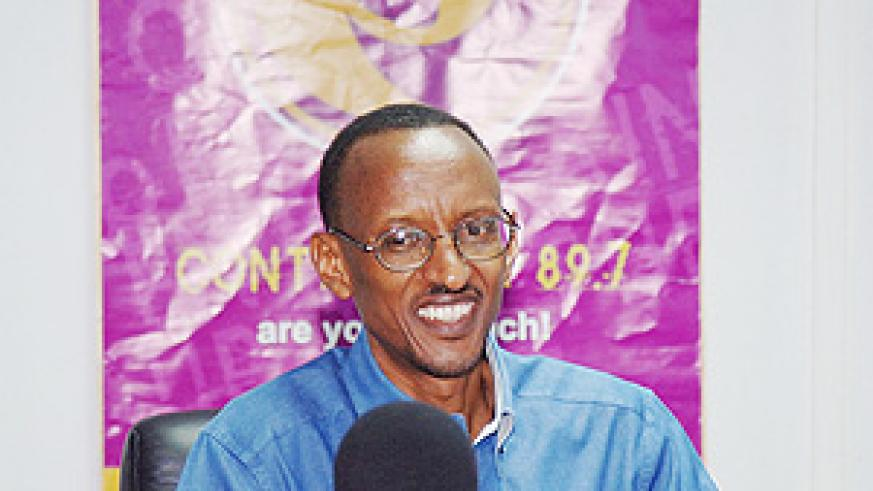 President Paul Kagame responding to callers' questions during Radio Contact FM's Crossfire session. (PPU Photo)