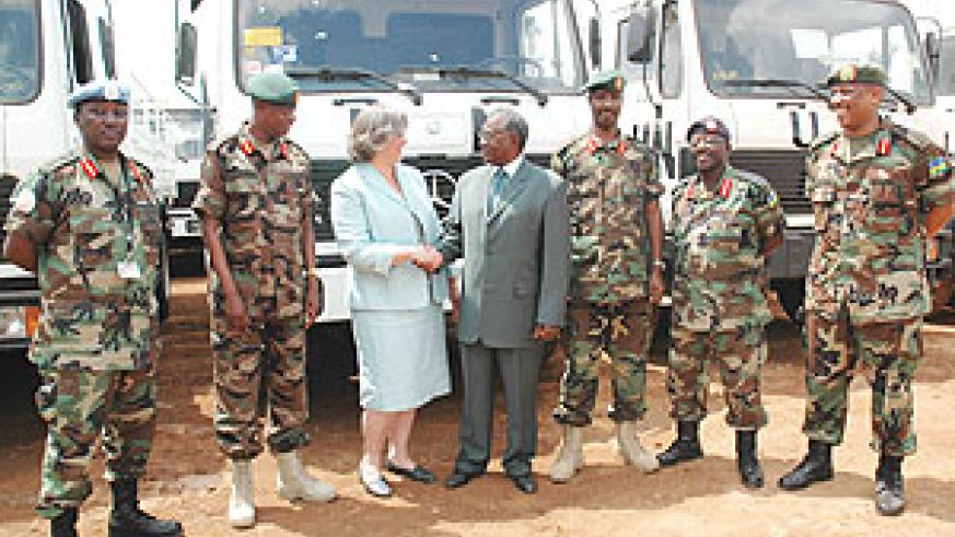 US Embassy Deputy Head of Mission, Cheryl Jane Sim hands over the equipment to Defence Minister Marcel Gatsinzi. They are flanked by top military commanders. (Photo / J. Mbanda).