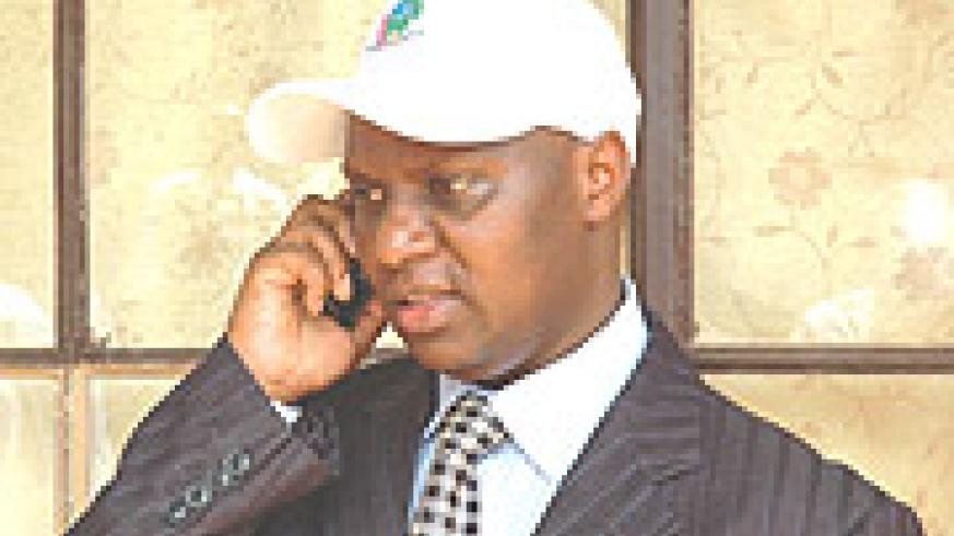 Communication Time- NEC Executive Secretary Charles Munyaneza talks to electoral officials from upcountry.