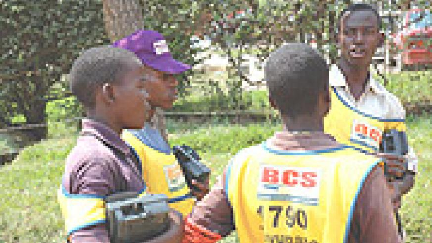 Some of the Tuvugane vendors carrying the M744 GSM handset. (File photo).