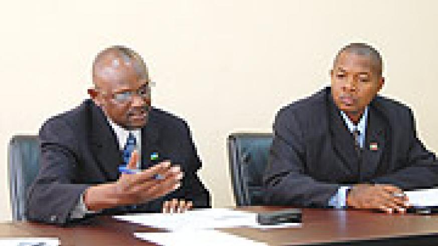 Director of Prisons, ACP Balinda Steven (L) and head of Burundi delegation Gabriel Nizigama at Ministry of Internal Affairs conference room.