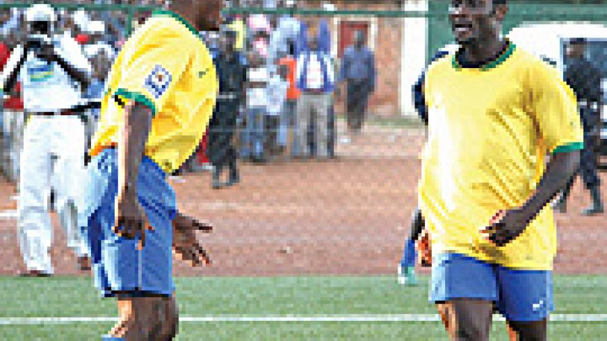 Bokota Kamana(L) and Said Abedi celebrate Rwanda's goal against Mauritania.The pair will be up against a much tougher opposition in the next round    (File photo)