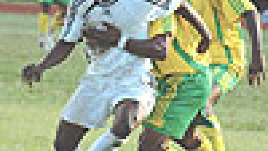 APR's Kabange Twite beats Atraco's Amoroso to the ball during a league game last season. Kabange will be instrumental in keeping APR within touching distance of Atraco. (File photo).