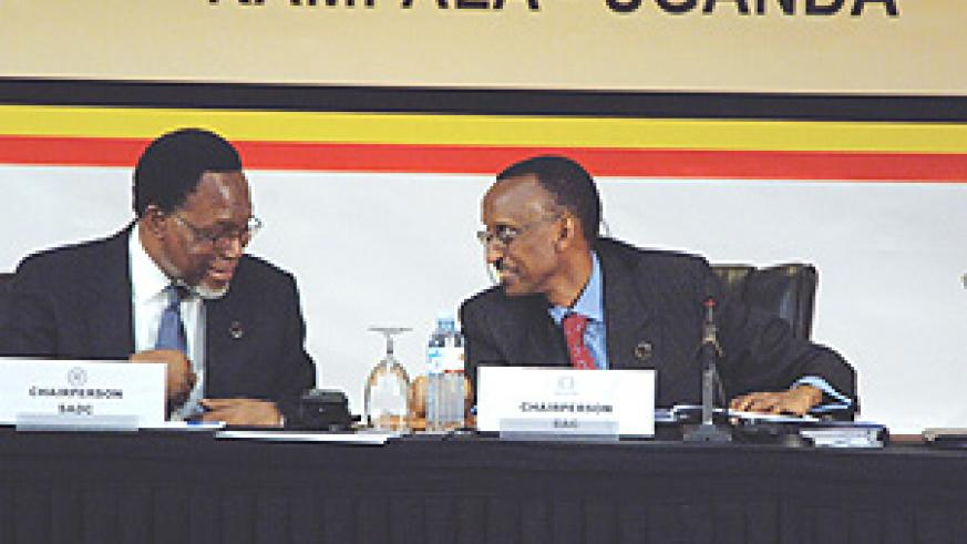 CAN WE TRADE? President Kagame sharing a light moment with South Africa's new President, Kgalema Motlanthe, during the Tripartite Summit in Kampala. (PPU photo).