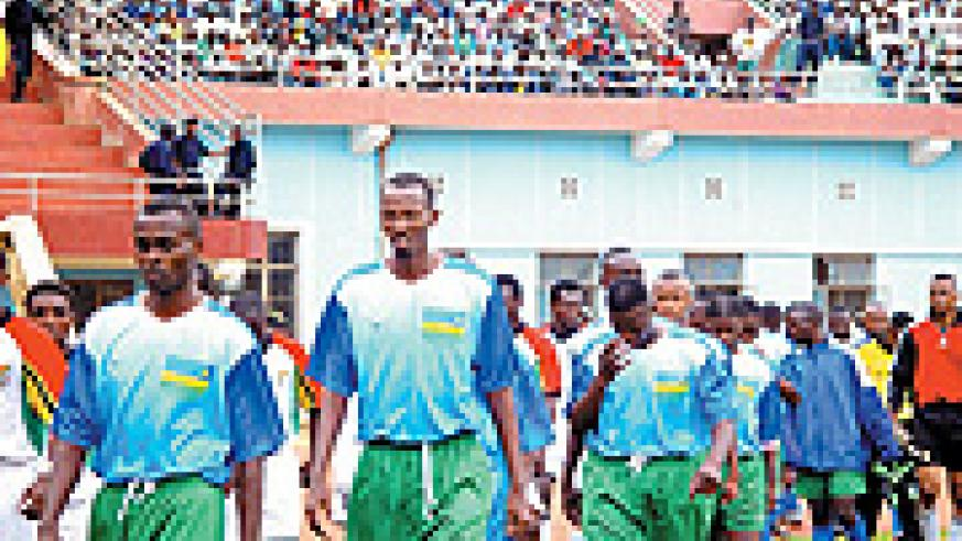 SWEET OLD DAYS: Defenders Leadre Bizagwira (front), Claude Kalisa (facing down) and midfielder Eric Nshimiyimana (middle) lead Amavubi out against Ghana's Black Stars at Amahoro. Rwanda won 1-0 through Jimmy Gatete's header to qualify for her maiden Natio