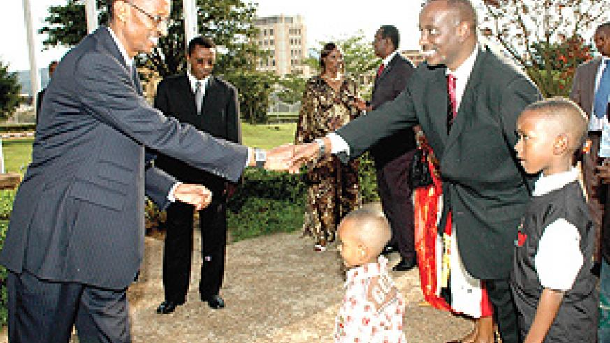 President Kagame congratulates Dr. Richard Sezibera outside Parliament after the latter had sworn in as Health Minister. (PPU photo).