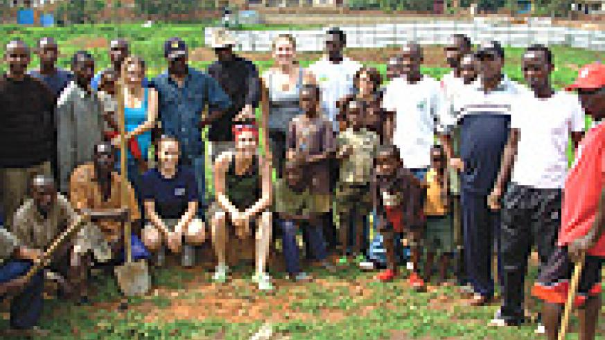 The Canadian interns with some of the volunteers after the tree planting excercise. (Photo/ F.Mutesi).