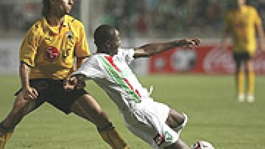 Omonoia Nicosia's Hamad Ndikumana(R) battles AEK's Ignacio Martin Scocco during a UEFA Cup tie. The Amavubi star will decide his future after 2010.