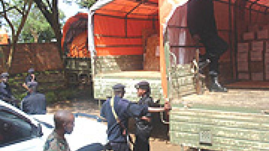 SECURE:  National O and A Level exam papers being watched over by Police and the Army during loading for various destinations. (Photo/ J.Mudingu).