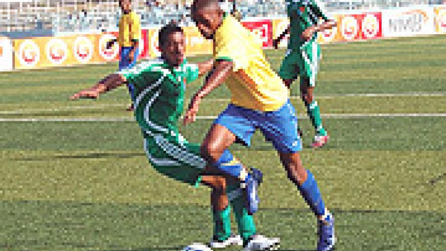 Amavubi Star Patrick Mutesa Mafisango in action during last year's Cecafa Cup. The centre of the park kingpin is expected to be an integral part inTucak's plans.(File photo)