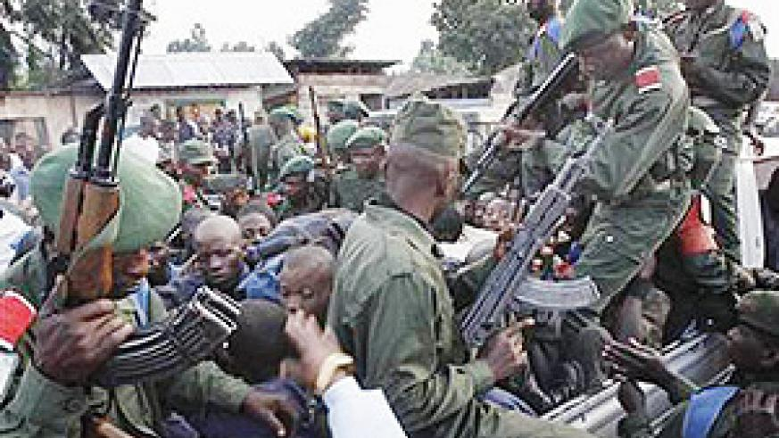 Congolese soldiers beating up civilians they picked up in Kibati last sunday.(Net photo)