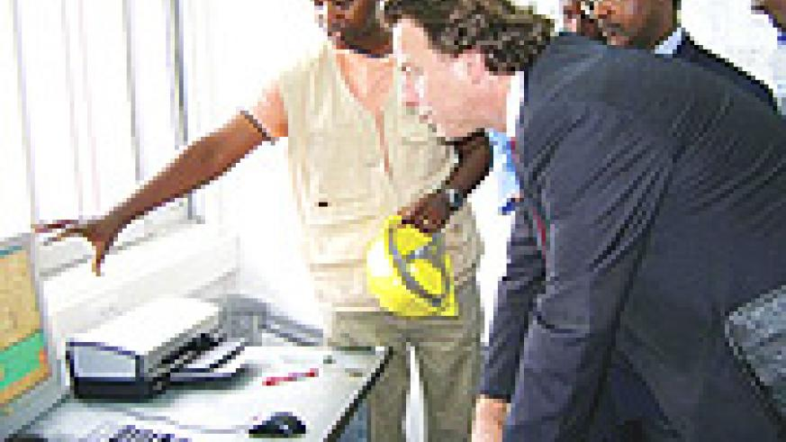 Dutch minister of   International Development cooperation, Bert Koenders, being briefed about  the Gisenyi methane gaz project  while  Minister Butare look on. (Photo / M. Tindiwensi).