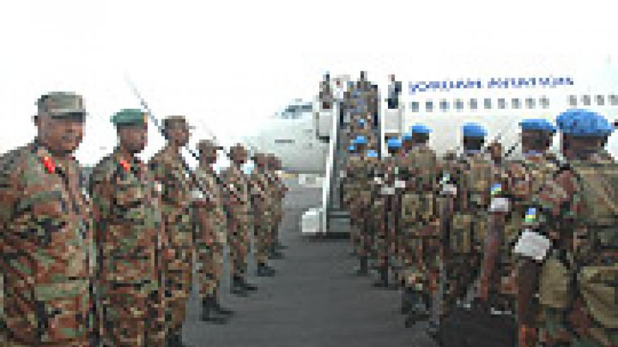 Chief of Defence forces General James Kabarebe (R) and Col Kamili Karege see troops off bound for Khartoum at Kigali International Airport Yesterday. (Photo/ J Mbanda).