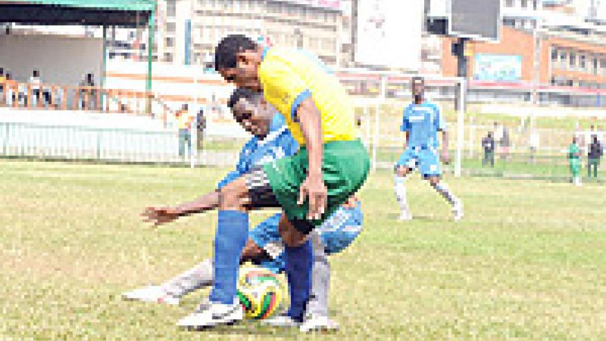 Amavubi striker Bokota Kamana beats off a challenge from a Somalian defender. The striker is set to retain his starting place today. (Photo / A. E. ORYADA)