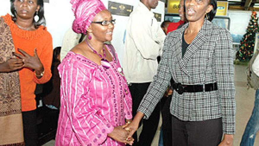 Member of Parliament Henriette Sebera, (left) bids farewell to Rose Kabuye  at  Kigali International Airport shortly before her return to France. (Photo PPU).
